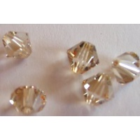 Swarovski bicone 4 mm Crystal Golden Shadow